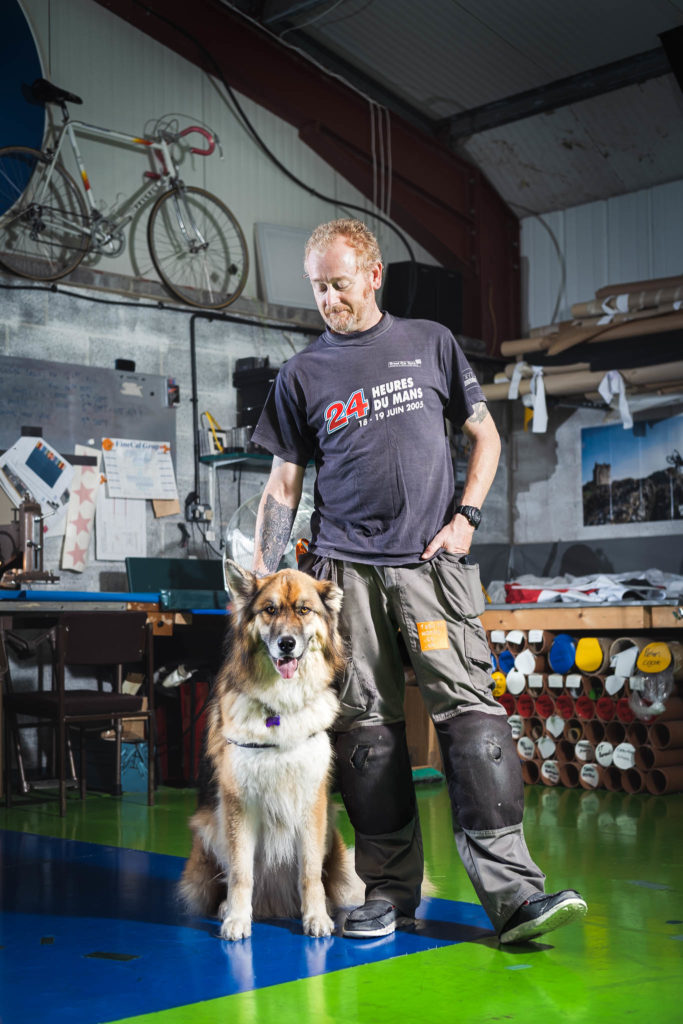 A portrait of Colin Puckle and his dog Ted in Cheddar Fabricworks